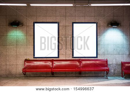 Two White Isolated Advertisement Billboard Posters on Train Subway Station Tile Texture Interior Flourescent Lights