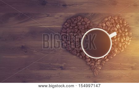 Top view of cup of coffee standing on coffee beans shaped like a heart on wooden table. Concept of liking coffee. 3d rendering. Mock up. Toned image