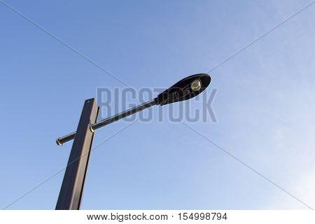 Modern Led street light lamp on the background of blue sky.