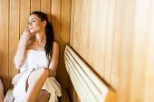 Woman sitting on the bench in the sauna poster