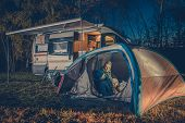 Caucasian Family Camping Fun. Caucasian Family in the Tent. RV Motorhome Camper in the Background. poster