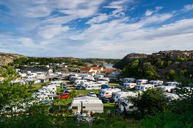 A view from above of a vacation trailer park camping on a nice summer day.