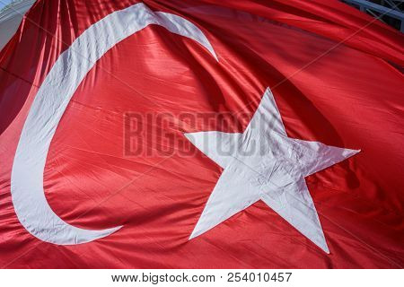 Close up Waving Fabric Flag of Turkey, Turkish National Flag Fabric Background Texture, Turkey Flag Blowing in the Wind, Realistic Flag of Turkey on Wavy Surface of Fabric, Fluttering Downwind