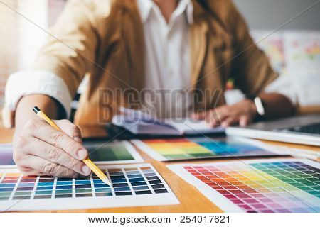 Young Creative Graphic Designer Using Graphics Tablet To Choosing Color Swatch Samples Chart For Sel