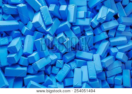 An image of some soft blue foam cuboids