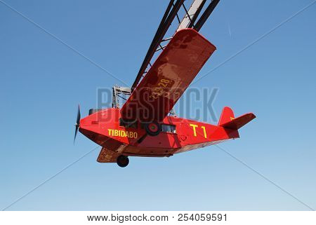 BARCELONA, SPAIN - APRIL 18, 2018: The iconic El Avio aeroplane ride at the Tibidabo Amusement Park on Mount Tibidabo. The ride has been operating since 1928.