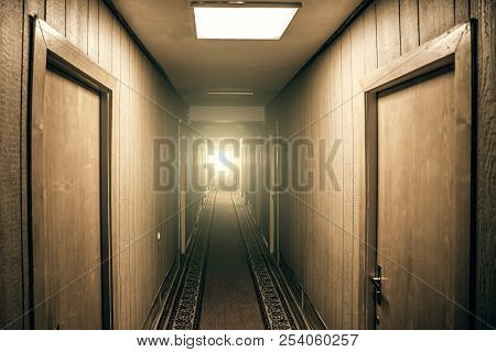 Empty Corridor In Apartment Building With Doors And Light In The End Of Hall, Perspective, Vintage T
