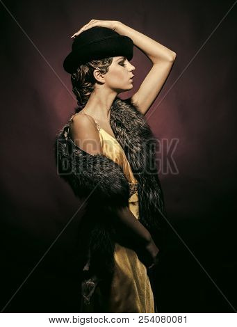 Look And Retro Style, Pinup. Pin Up Pretty Fashion Model Pose On Burgundy Background. Woman With Sty
