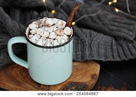 Blue And Black Enamel Cup Of Hot Cocoa With Marshmallows And Cinnamon Bark. Extreme Shallow Depth Of