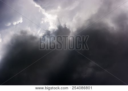 Storm Cloud On Sunny Day. Light In The Dark And Dramatic Storm Slouds. Background Of Storm Clouds Be