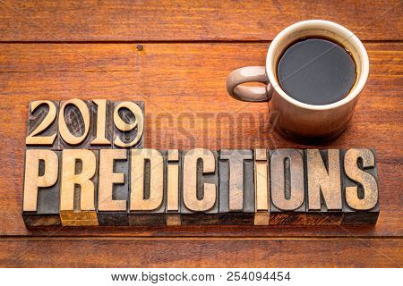 2019 prediction concept - text in vintage letterpress wood type printing blocks with a cup of coffee
