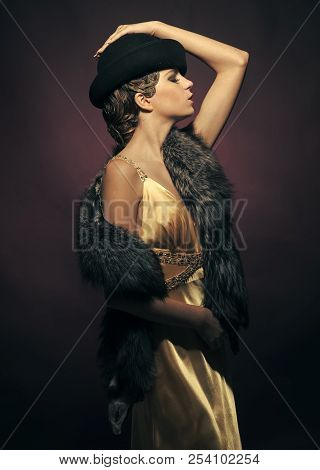Beauty And Vintage Fashion. Girl In Fashionable Yellow Dress, Hat And Fur. Pin Up Pretty Fashion Mod