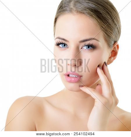 Young woman touching her face and neck. Beauty treatment for young beautiful female face. Skin care, beautician treatments, body wax, mink eyelashe, eyebrow grooming, permanent chin hair removal