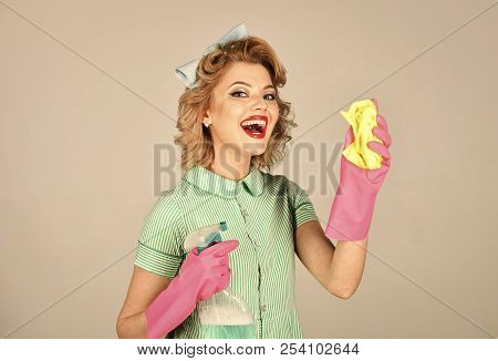 Housekeeper in uniform with clean spray, duster. Cleaning, retro style, purity. Pinup woman hold soup bottle, duster. Retro woman cleaner on grey background. Cleanup, cleaning services, wife, gender poster