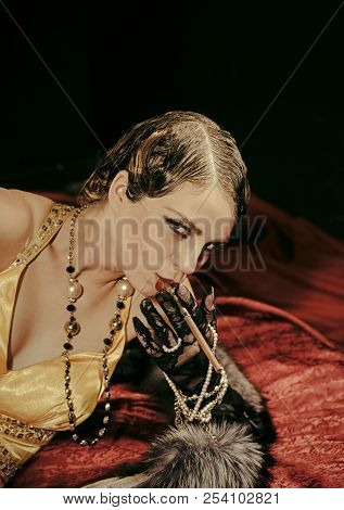 Beauty And Vintage Fashion. Girl In Yellow Dress And Fur With Mouthpiece. Woman With Stylish Retro H