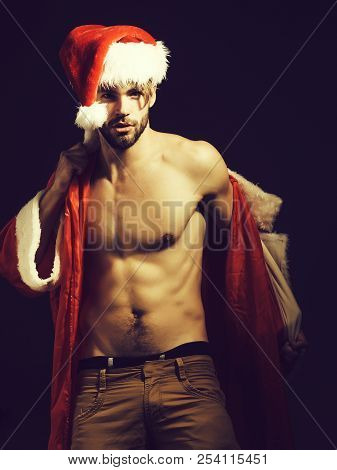 Handsome Santa Claus Guy Sexy Young Bearded Macho Christmas Man Model In Red Xmas Or New Year Coat A