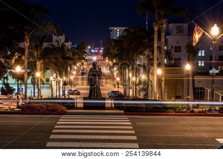 Morning Vehicles Lights Streaking Past Junipero Serra Statue Overlooking Downtown Ventura, Californi