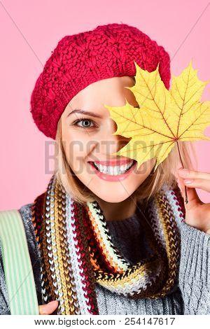 Autumn Model. Close Up Portrait Of Smiling Woman With Maple Leaves. Autumn Mood. Woman With Autumn L