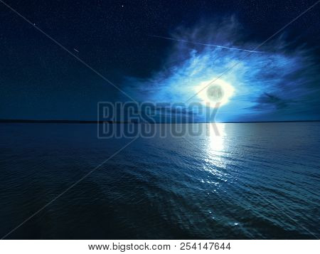 Beautiful Magic Blue Night Starry Sky With Clouds And Full Moon With Reflexion Of Moonlight In The W