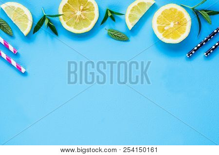 Creative Layout Made Of Summer Ingredients For Cocktail And Lemonade. Lemon Slices, Colorful Straw A