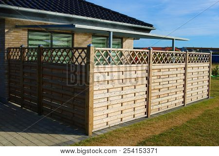Wooden Fence. Terrace Fence. Wooden Fence With Privacy Lattice Screen.