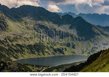 Great Polish Pond In Tatra Mountains, Lake In The Valley Of The Five Polish Lakes