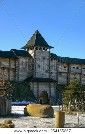 A Powerful Ancient Wooden Fortress With A Central Tower And A Gate. Historical Architectural Reconst