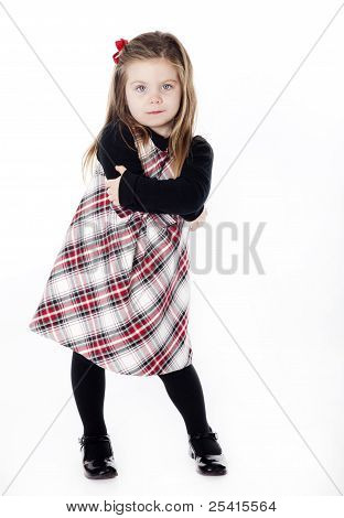 Young Pretty Girl In A Dress On White Background With Arms Folded