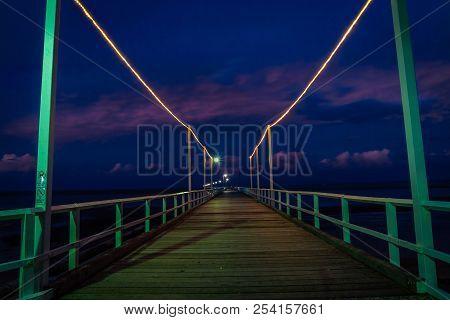 Urangan Pier By Night In Queensland, Australia