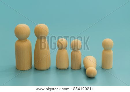 Concept Of The Child's Death. Concept Of The Death Of Child, Loss. Wooden Figurines Of Parents And C