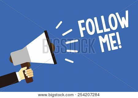Handwriting text writing Follow Me. Concept meaning Inviting a person or group to obey your prefered leadership Man holding megaphone loudspeaker blue background message speaking loud. poster