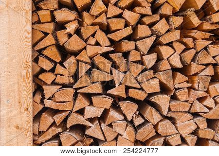 Chopped wood piled in a woodpile and prepared for heating in winter. Alpine Switzerland poster