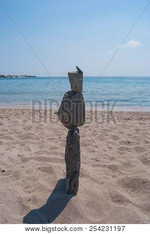 Pyramid Of Stones On The Beach And Leaden Sky