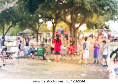Abstract Blurry Group Of Latino People Enjoy Bbq At Public Park