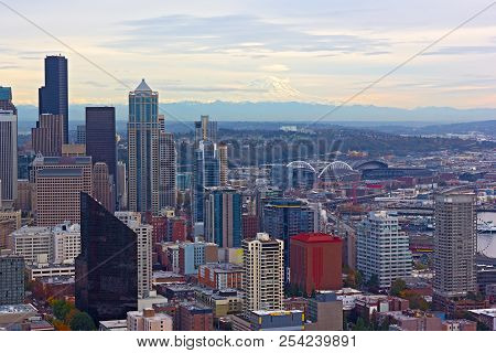 A View On Seattle Downtown And Mount Rainier At Autumn Sunset. Urban Panorama With Mountain Ridges A