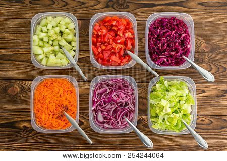 Plastic Containers Of Assorted Colorful Freshly Sliced Vegetables For A Salad Or As Individual Side