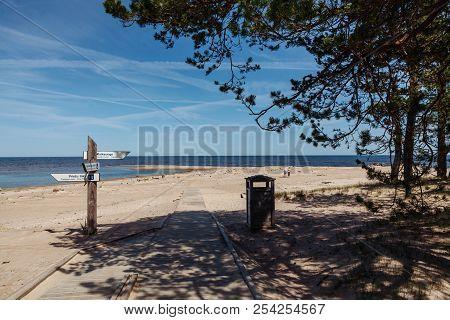 Pointers On The Pillar On The Beach. Cape Kolka. Latvia.