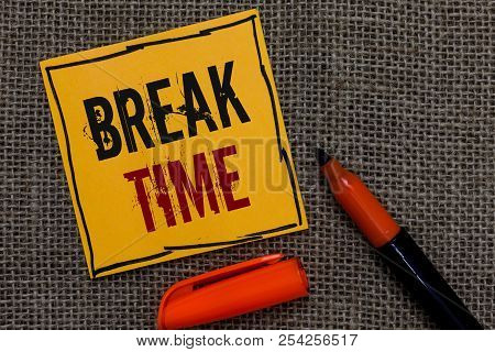 Conceptual hand writing showing Break Time. Business photo showcasing Period of rest or recreation after doing of certain work Orange paper Marker Communicate ideas Jute background. poster