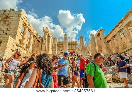 Athens, Greece - September 13 2016: Tourists Climb Up And Down The Steps To The Ancient Acropolis In