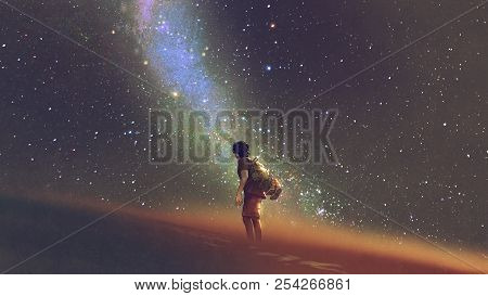 Young Man Standing On Desert And Looking Up Into The Night Sky With Stars And Milky Way, Digital Art