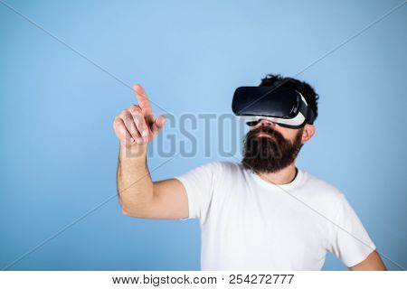 Man With Beard In Vr Glasses, Light Blue Background. Interactive Surface Concept. Guy With Head Moun