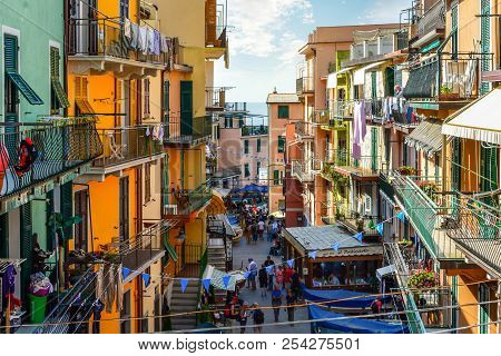 Manarola, Italy - September 25 2017: Tourists Walk The Main Street Past Cafes And Shops On Their Way