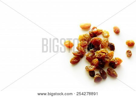 Raisin On White Background / A Raisin Is A Dried Grape. Raisins Are Produced In Many Regions Of The