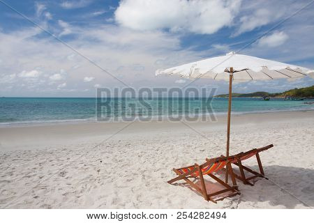 Beach Chairs On The White Sand Beach.