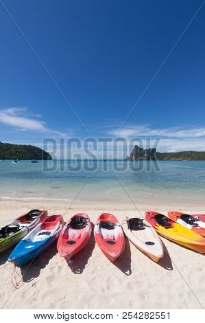 Colorful Kayaks On The Beach At Pi Pi Island