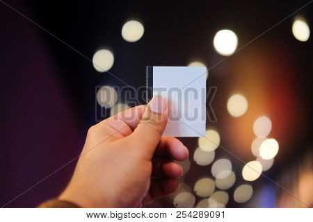 Young Man's Hand Holding A Paper Ticket