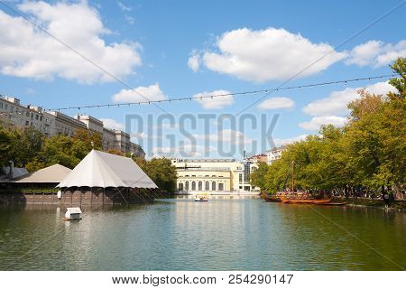 Moscow, Russia - August 17, 2018: Pond, Boats, Trees And Buildings In Chistoprudny Boulevard. This P