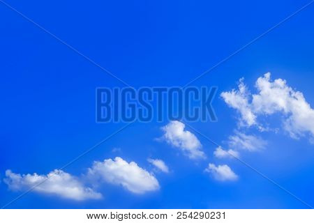 a bright blue sky with clouds background