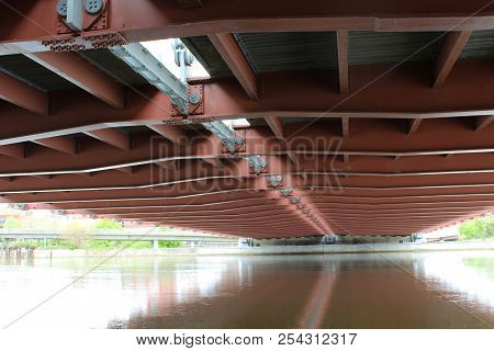 Bridge Across The Genesee River. A Different View From Below. Reflections On The Water