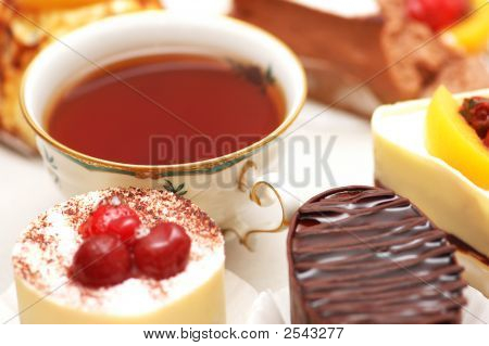 Sweet Cake With Berries And A Cup Of Tea